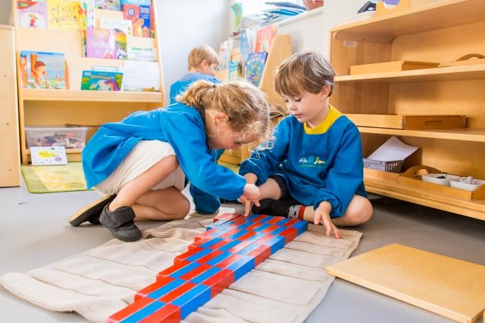 children working with Montessori resources