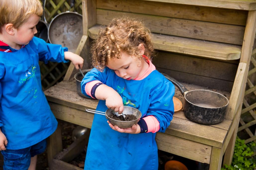 Girl making mud meal