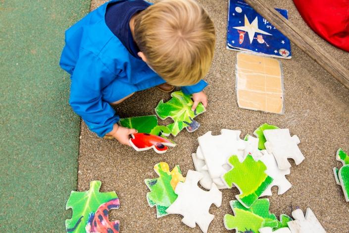 boy doing jigsaw