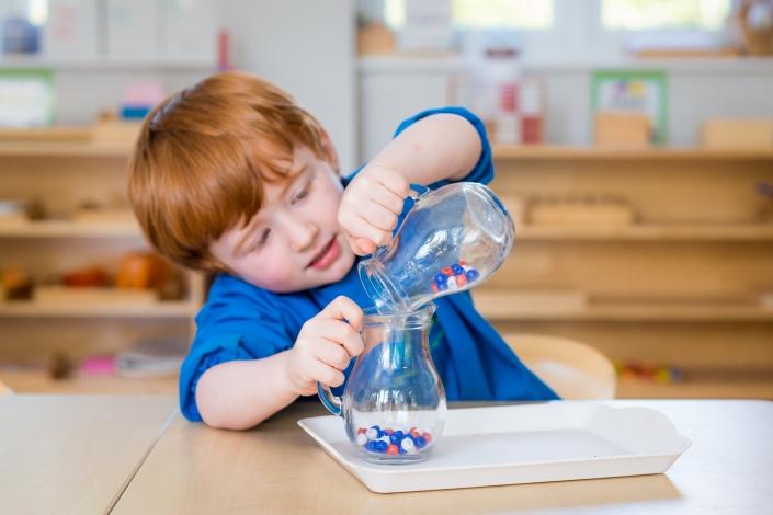 boy using Montessori resources