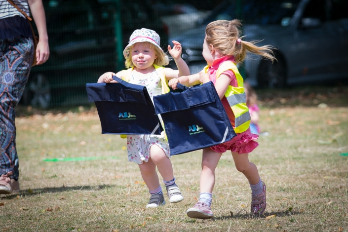 girls running with bags